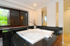 Luxury private Villa apartment 308 - Master Bedroom with private lounge and Large Corner Spa Bath
