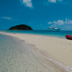 Visit a secluded sand cay in your superyacht on the Great Barrier Reef
