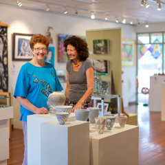Visit the art galleries in Kuranda Village