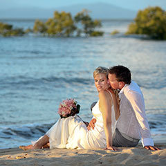 Wedding couple posing on the beach in Port Douglas