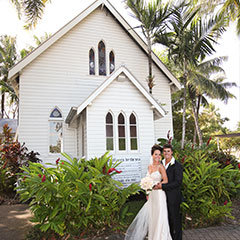 Wedding couple posing outside St Mary's Chapel in Port Douglas