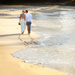 Wedding couple strolling the beach at Port Douglas