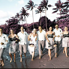 Wedding party strolling the beach in Port Douglas